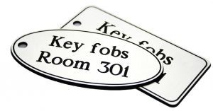 50x100mm Key fob oval - White text on blue